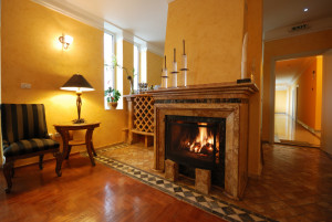 Hotel apartment with fireplace.